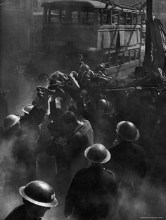 Rescue workers helping pull victim from ruins of a building hit by a rocket during World War II. Photo by George Rodger. London History, British History, World History, World War Ii, War Photography, Vintage Photography, Magnum Fotografie, Fosse Commune, The Blitz