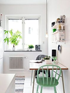 white kitchen nook with a pop of green