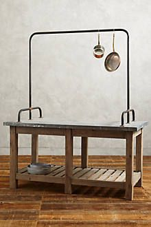 A history-rich, handcarved piece for your kitchen, this sturdy island is crafted from reclaimed, 19th-century timber from Hungary. Accessible from both sides, it features eight utility hooks, a slatted storage shelf and a galvanized zinc top that gets more beautiful with age.