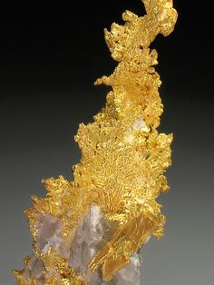 Gold on Quartz, From the Eagle's Nest Mine, Placer County, California.  Measures 9.3 cm by 4.2 cm by 2.4 cm in total size.