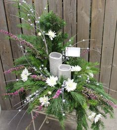 Two silver glitter memory candles in fresh greens arrangement
