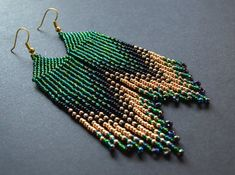 Items similar to Long beaded green gold earrings on Etsy Brick Stitch Earrings, Seed Bead Earrings, Boho Earrings, Earrings Handmade, Handmade Beads, Seed Beads, Drop Earrings, Beaded Earrings Patterns, Beaded Jewelry