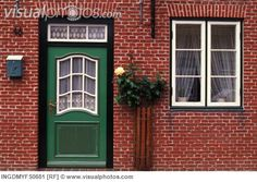 green door with red brick house - Google Search