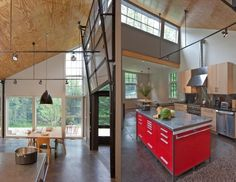 I love the use of plywood for the ceiling and concrete floors.
