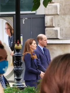 The Duchess of Cambridge sported a shirt of a brighter blue beneath her navy suit, while W...