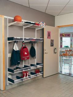 Elfa Rocks The Entryway! Beautiful Use Of Shelves, Hooks And Shelf Baskets  To Corral Shoes.