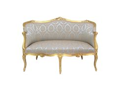 A late 19th century, French, carved giltwood canapé in the Louis XV style. The acanthus carved mahogany showframe with shaped back and open arms, supported on cabriole legs. Newly reupholstered in a pale blue brocade. Regilded. French, c.1890. Exhibitor: Tim Saltwell - The Art & Antiques Fair Olympia