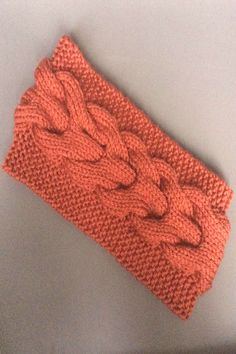 This lovely warm cabled ear warmer headband pattern is now in stoYou can find Knit headb. Knit Headband Pattern, Knitted Headband, Knitted Hats, Knitting Stitches, Knitting Patterns, Ear Warmer Headband, Cat Doll, Make Your Own, How To Make