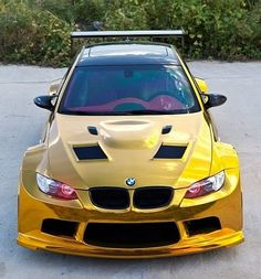 Front view of the tricked-out golden BMW.