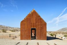 """Exterior, Gable RoofLine, Cabin Building Type, Metal Roof Material, and Metal Siding Material Naturally rusted steel sheathes the cabins that Malek Alqadi built on a 1954 homestead outside Joshua Tree National Park. """"I loved the idea of stitching the existing structure back together, reinforcing it, and giving it life again without compromising the beautiful setting it's in,"""" he says.  Photo 1 of 13 in These Tiny, Off-the-Grid Cabins Near Joshua Tree Look Totally Apocalypse-Proof"""