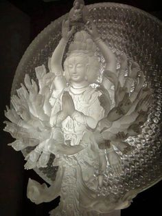 Kuan Yin's many hands of compassion