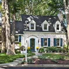 The most adorable white washed brick home w/the most fabulous blue door & shutters.   via/ by @anthonywilderdesignbuild
