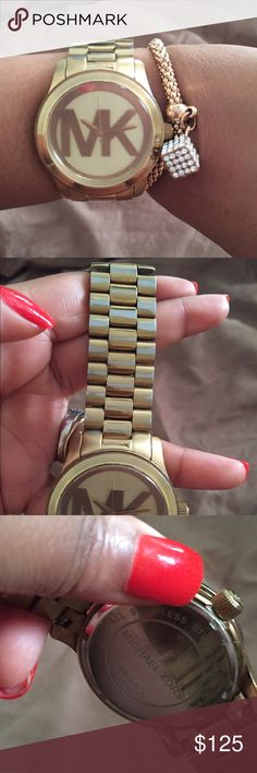 Gold MK watch ⌚️ Beautiful Big dial gold MK watch. Used with some rubbing off of the gold on one side. It's in good shape. Needs new battery. Michael Kors Accessories Watches