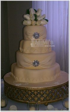 Our First Wedding Cake.  Cream and Gold with Flowers on Top