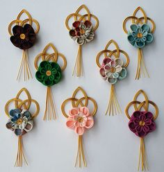 Mizuhiki Boutonnieres ... gold cords with fabric flowers ...