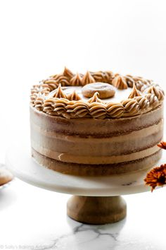 This snickerdoodle layer cake combines my favorite vanilla cake with buttery brown sugar cinnamon swirl and brown sugar cinnamon buttercream. If you love snickerdoodle cookies, you will adore this homemade cake! Recipe on sallysbakingaddiction.com