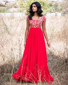 Beautiful red color floor length designer anarkali dress with floret lata design hand embroidery thread work on y yoke.Brook collection of Mrunalini Rao . 28 April 2018