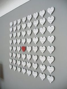 Heart mural out of old book pages.
