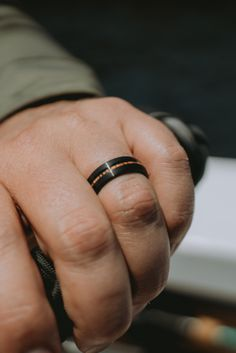The Black Forest - Men's black wedding ring with a natural koa wood inlay. Free resizing! Over 40+ wooden wedding rings to pick from....