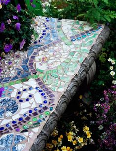 Bench beauty Ribbons of square glass tiles entwine on the surface of a concrete garden bench. The pattern also includes blue glass pebbles and pieces of an heirloom cake plate. http://www.midwestliving.com/garden/ideas/create-mosaic-magic-in-your-garden/?page=13