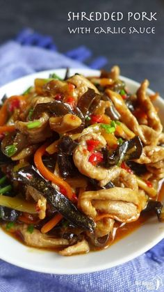 Signature dish of Sichuan cuisine, shredded pork with garlic sauce delivers a sophisticated and addictive taste: tangy, spicy, sweet & sour. #ChineseFoodRecipes