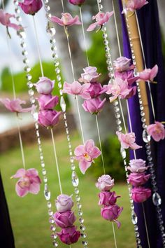 Flower curtain made of hanging purple flowers and crystals. Beautiful!