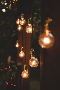 Hanging lights, fairy lights, lanterns on trees and the back deck to improve the atmosphere.