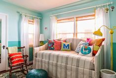 I love pairing turquoise with a rainbow of color…it just makes me so happy! So imagine my delight seeing this cheery Long Beach, California nursery designed by Susie Ho of the boutique design…