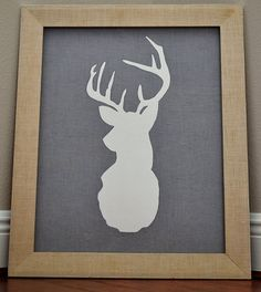 My sister and I created this deer head painting yesterday. The hardest part was taking the picture. It took a 3 dollar thrifted frame, cardboard, fabric, spray adhesive, an old school projector, a homemade stencil, white acrylic paint, a staple gun and an hour long kettle corn eating event.