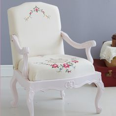 Chair with tablecloth upholstery. We found a beautiful old chair frame, painted it and used the prettiest parts of a stained tablecloth to upholster it.
