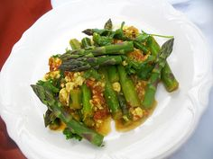 Raghavan Iyer's recipe for Asparagus with Shredded Paneer Cheese and Tomato from 660 Curries.