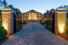 Square Foot Stately Brick Colonial Mansion In Roswell, GA Front Gates, Entrance Gates, House Entrance, Driveway Lighting, Driveway Entrance, Gate Lights, Colonial Mansion, Driveway Design, Gate Design