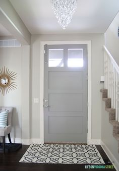 Love this entryway and gray door - full source list for everything in this space too!