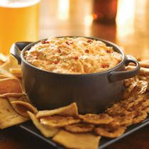 BUFFALO CHICKEN DIP—8 ounces softened cream cheese; 1/2 cup ranch dressing; 1/2 cup any flavor Frank's® RedHot® Sauce; 1/2 cup shredded mozzarella cheese; 2 cups shredded cooked chicken.  Combine ingredients in crock pot.  Heat on HIGH setting for 1-1/2 hours until hot and bubbly or on LOW setting for 2-1/2 to 3 hours. Stir.
