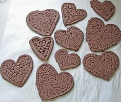 Textured clay hearts.