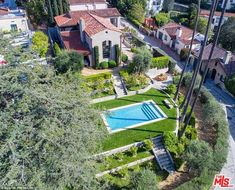 Paradise: The pool is surrounded by a lush green garden