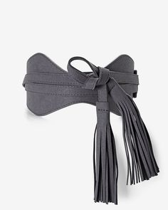 "Enhance your favorite blouse or flowy boho dress with this faux suede obi belt, which reverses to an exotic lizard pattern. Reversible obi belt Tassel detail Sized at the waist Approx. 3 1/2"" wide front tie close Polyester/polyurethane Imported"