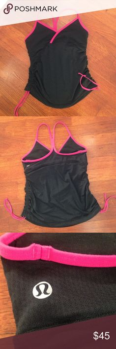Lululemon Black & Bright Pink Workout Tank So cute with gathered sides!  Cross front design and racer back.  Removable pads not included.  I feel this style runs a bit small.  I'm a standard 4 in lulu and thus one just feels a little too small.  Worn/washed a few times. No snags or stains. lululemon athletica Tops Tank Tops