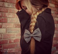 side braid with grey bow. girly hairstyle.