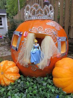 Fall Decorations & Fall Decorating Ideas - CINDERELLA PUMPKIN - No fairy godmother necessary for this fun D.I.Y. Create your very own sparkly princess carriage with some glue, bedazzling jewels, and carving knives. Get the how-to at Redbookmag.com.