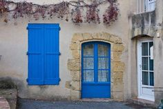 typical blue door and shutters in early evening in Lourmarin, Provence