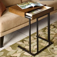 $129 Ink and Ivy Wynn Pull Up laptop Desk store up to a 15-inch laptop inside the hidden drawer. The Wynn laptop desk is constructed of Oak veneers over medium density fiber board.