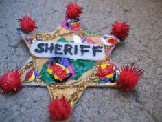 Sheriff's Badge- could either cut out of paper (I can do on my Cricut) or buy wooden ones from Hobby Lobby and let kids decorate. Add some kind of way for kids to wear them.