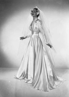 Chaloner Woods / Getty Images - A satin wedding dress with a long veil, also by Mercia. Vestidos Vintage, Vintage Gowns, Vintage Outfits, Dress Vintage, Vintage Wedding Photos, Vintage Bridal, Vintage Weddings, Bride Gowns, Bridal Dresses