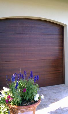 These are faux painted to look like wood www.garagedoor4less.com