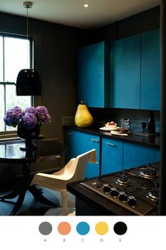 add a little peacock blue to your life. And why NOT have an over-sized pear on the counter? What else would you do with counter space?
