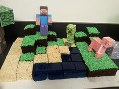 The ultimate Minecraft Birthday Cake - This cake was made for a Minecraft themed birthday party at our arcade.  It is made with rice crispy treats, blue jellow jigglers, and square chocolate cake pieces with green icing.