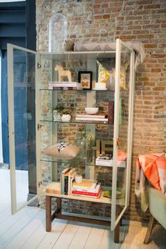 I would use this glass cabinet in the dining room or as a book shelf in the living room