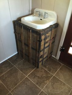 Ugly sink with visible piping? Not today! Cover them up with an old trunk!