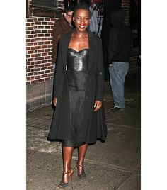 @Who What Wear - J. Mendel                 Following her appearance at the Late Show With David Letterman, Nyong'o was photographed in a structured J.Mendel Resort 14 Black Bustier, black pencil skirt, Christian Louboutin Geotistrap Pumps and Graziela White Diamond Earrings ($2900).